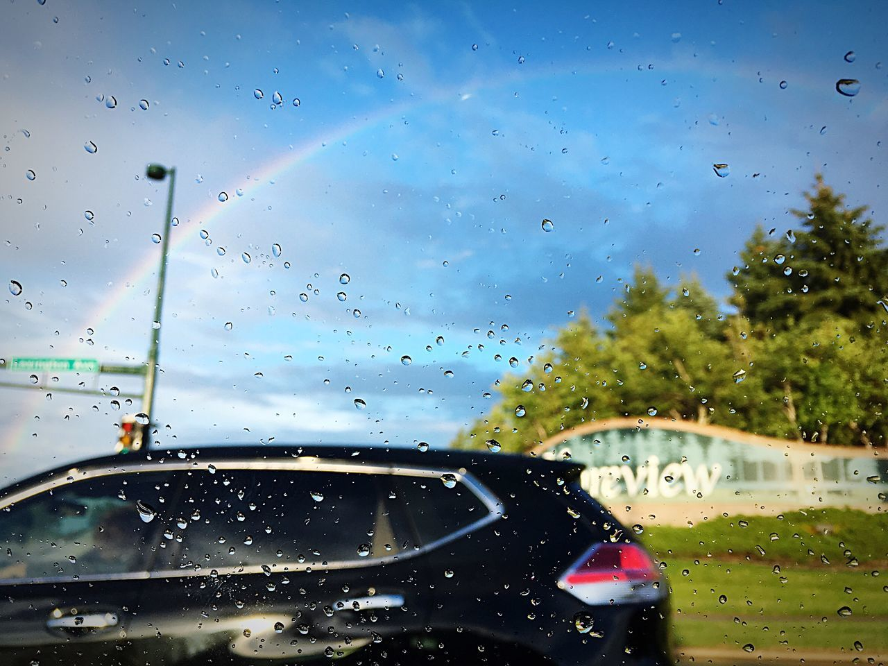 transparent, drop, rain, glass - material, water, wet, vehicle interior, raindrop, mode of transport, transportation, land vehicle, rainy season, droplet, car interior, windshield, no people, water drop, car, sky, window, focus on foreground, close-up, nature, day, outdoors