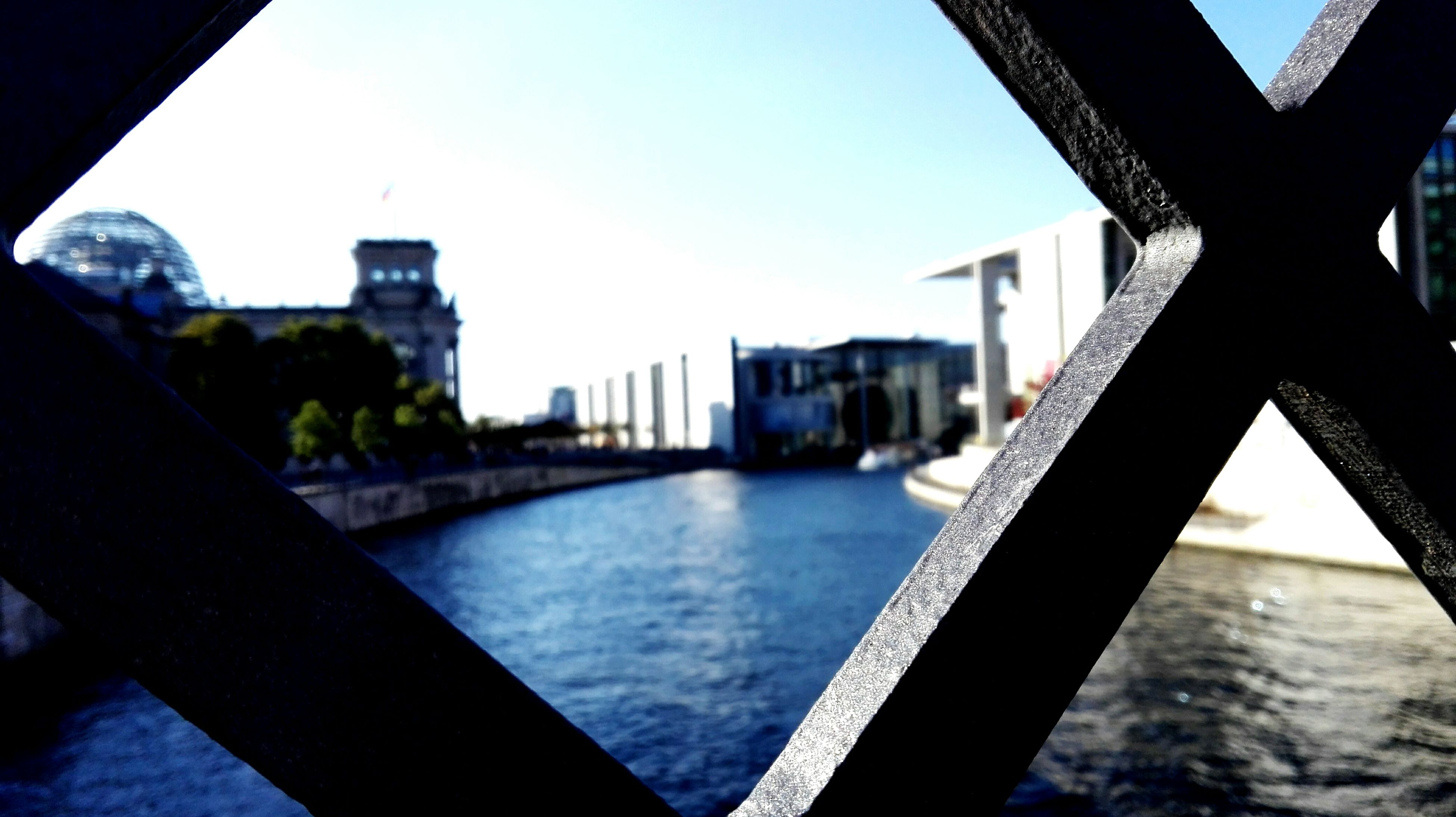 architecture, built structure, water, building exterior, clear sky, river, city, bridge - man made structure, connection, metal, cityscape, sky, bridge, railing, close-up, blue, day, reflection, no people, indoors