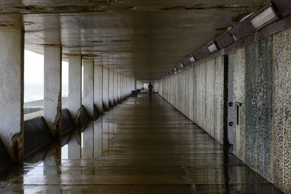 Perspectives Art Is Everywhere Beach Eye4photography  EyeEm Best Shots EyeEm Masterclass Hastings Leading Lines One Person Pedestrian Tunnel Perspective Perspectives Reflection Reflections Sea Street Photography The Secret Spaces Tunnel Unrecognizable Person Wet Break The Mold TCPM