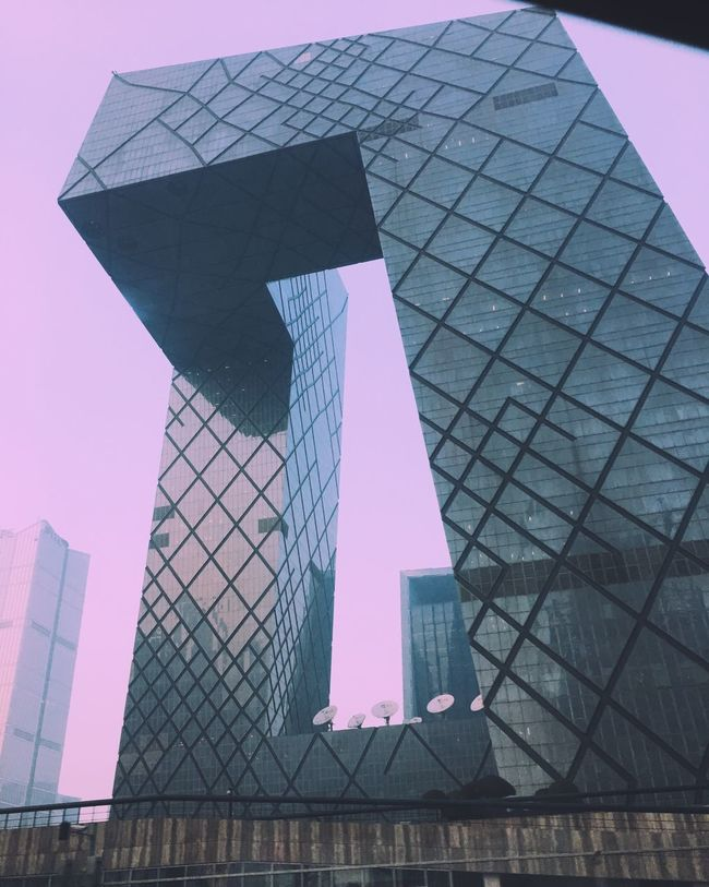 Architecture Built Structure Building Exterior Skyscraper Low Angle View Tower Tall - High Modern Glass - Material City Reflection Office Building Tall Clear Sky Sky Urban Skyline Outdoors Building Story Development Day Beijing Tvstation Manmade Skycolor