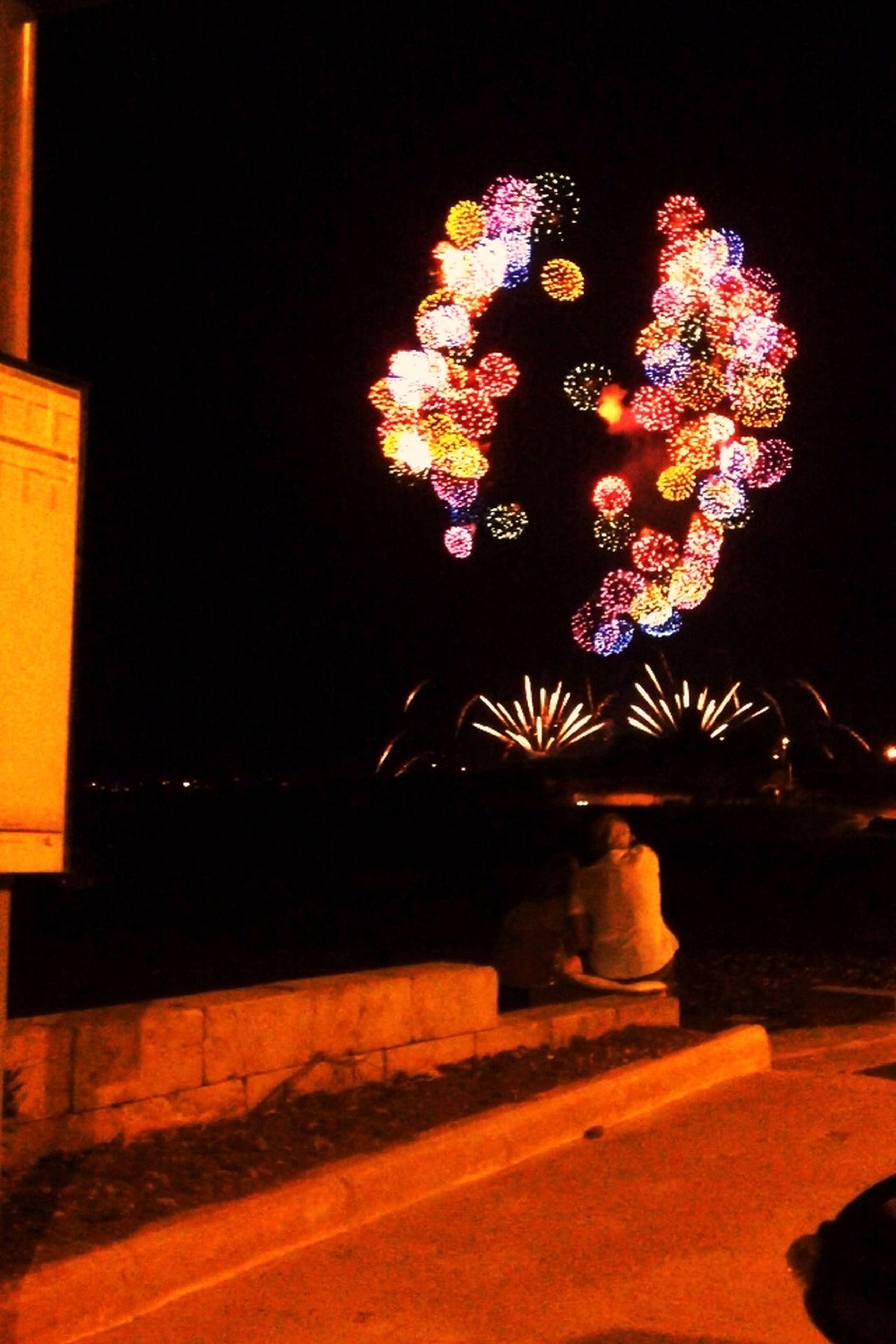 illuminated, night, celebration, glowing, decoration, creativity, art, art and craft, arts culture and entertainment, lighting equipment, long exposure, firework display, light - natural phenomenon, tradition, low angle view, exploding, motion, christmas, multi colored, firework - man made object