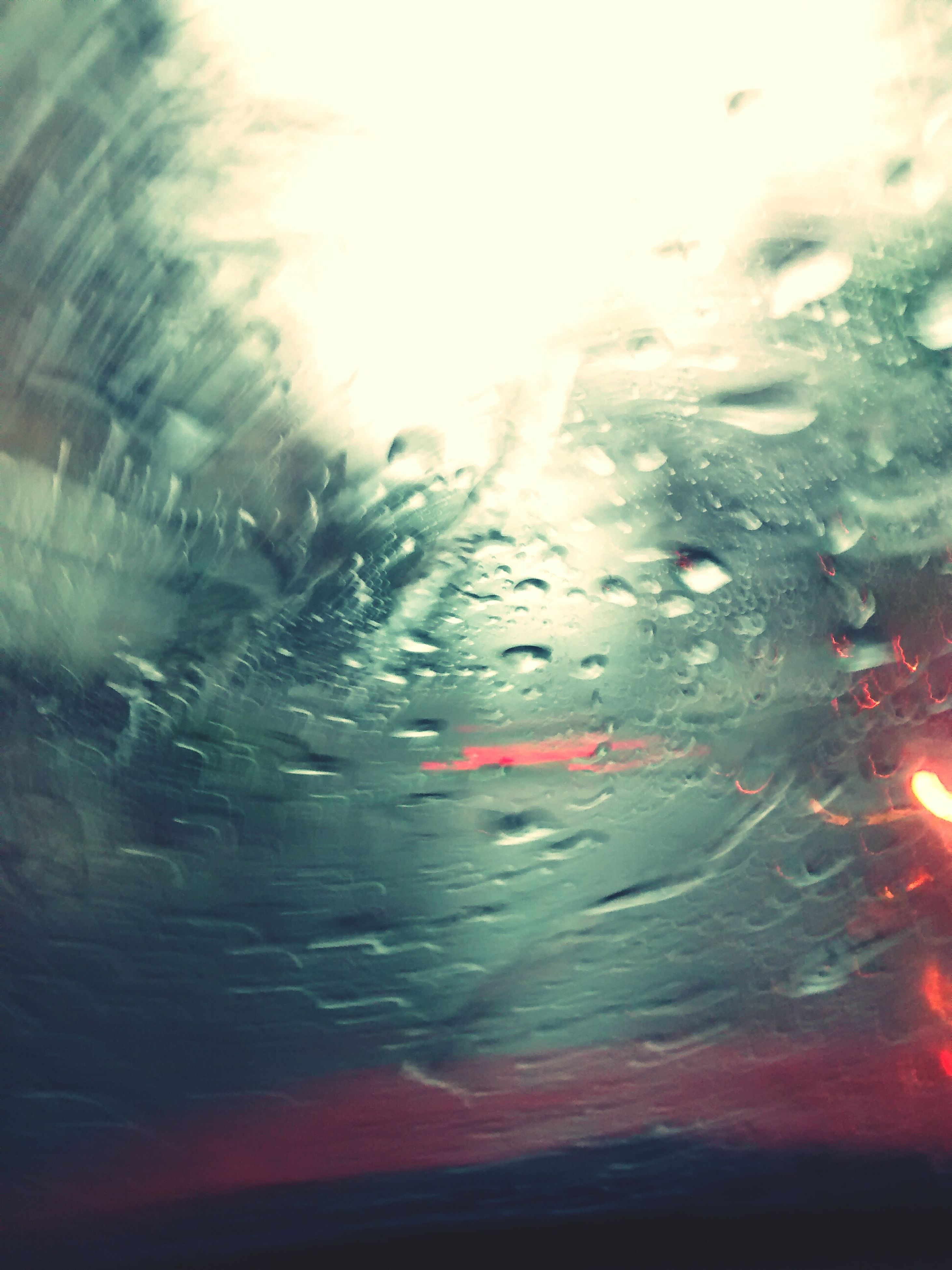 transportation, mode of transport, transparent, car, land vehicle, glass - material, window, water, wet, rain, vehicle interior, drop, on the move, reflection, windshield, sun, motion, lens flare, street, travel