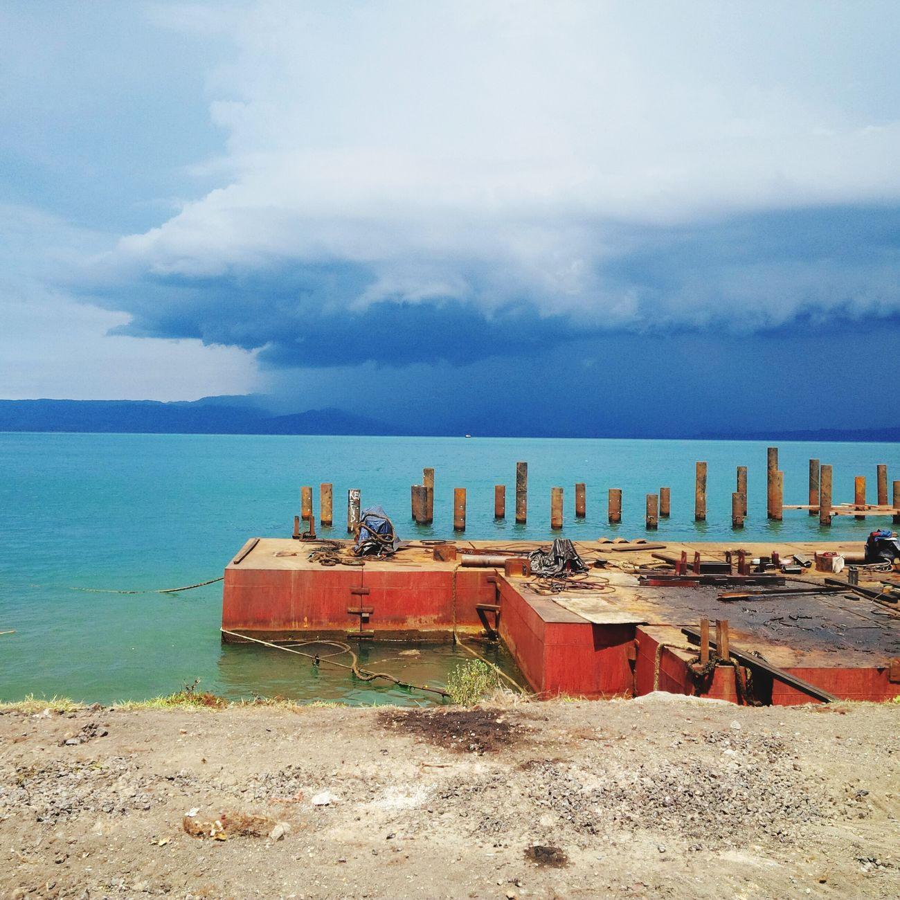 Amurang port.. Beach Sea Sand Water Horizon Over Water Lifeguard  Business Finance And Industry Cloud - Sky Sky Nautical Vessel Day Outdoors Red Industry No People Wave Architecture Nature Oil Pump