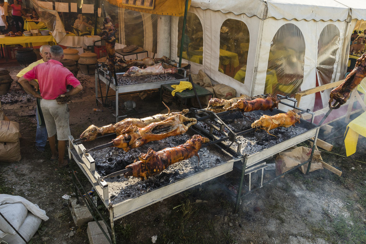 real people, one person, food and drink, day, men, barbecue, outdoors, large group of animals, standing, food, freshness, building exterior, one man only, bird, adult, people