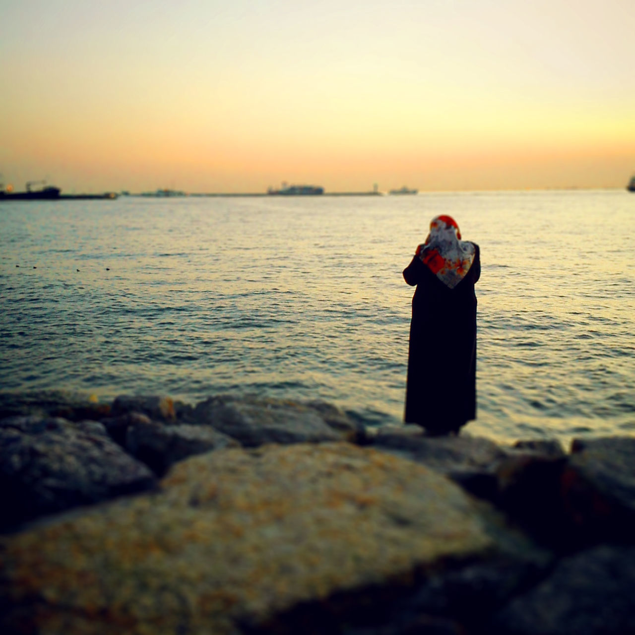 sea, water, sunset, real people, one person, nature, beauty in nature, standing, horizon over water, scenics, tranquil scene, leisure activity, outdoors, sky, beach, tranquility, idyllic, lifestyles, clear sky, vacations, women, full length, camera - photographic equipment, photographing, photography themes, young women, day, young adult, people