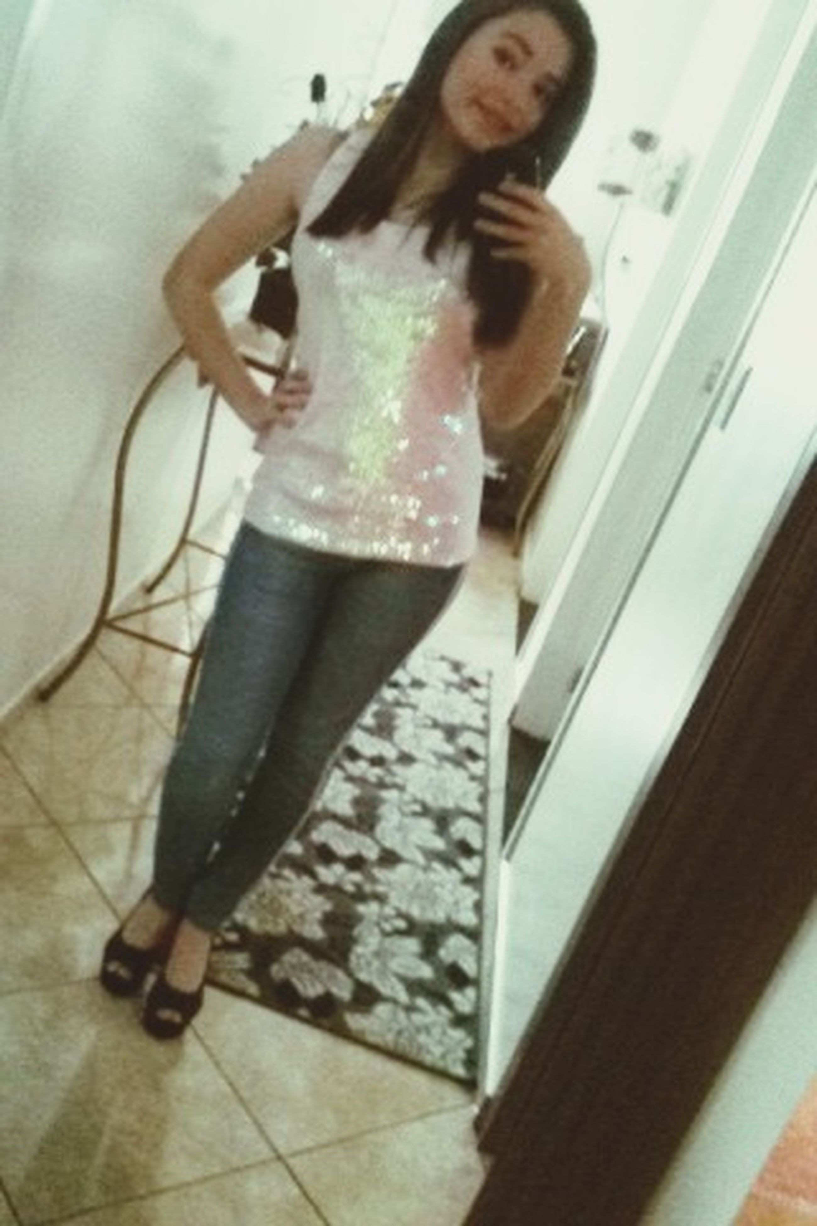 indoors, lifestyles, young adult, person, casual clothing, young women, full length, leisure activity, standing, front view, reflection, three quarter length, home interior, technology, looking at camera, mirror, holding