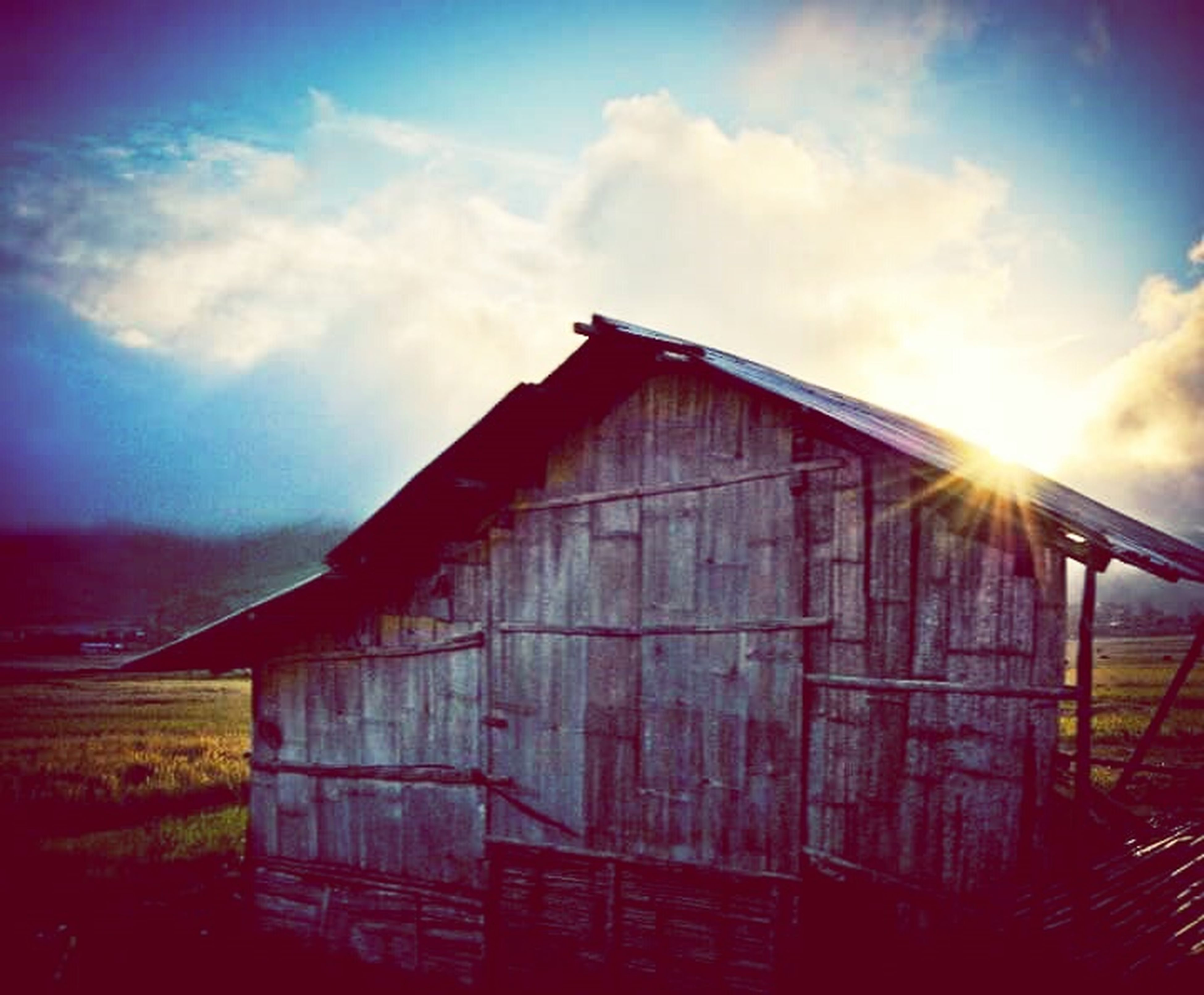 architecture, built structure, building exterior, sky, cloud - sky, sun, low angle view, sunlight, sunset, sunbeam, cloud, safety, house, protection, fence, no people, outdoors, cloudy, lens flare, metal
