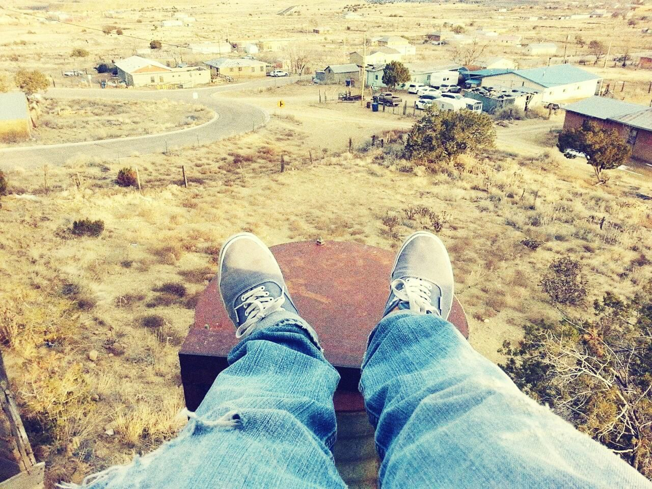 personal perspective, shoe, one person, real people, human leg, low section, standing, human body part, high angle view, men, day, lifestyles, outdoors, landscape, nature, grass, one man only, people