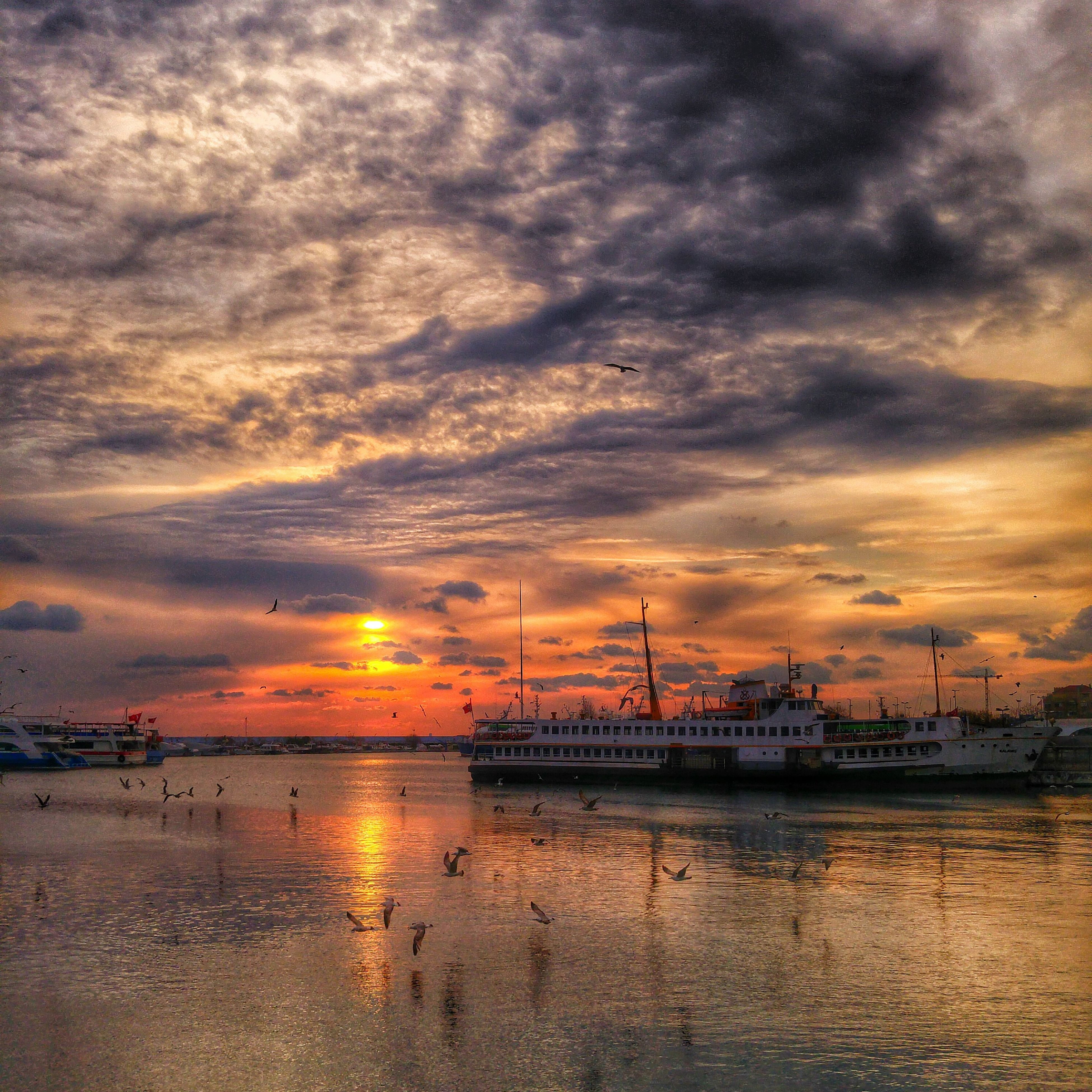sunset, water, sky, nautical vessel, sea, cloud - sky, transportation, mode of transport, boat, orange color, scenics, cloudy, beauty in nature, moored, waterfront, dramatic sky, tranquility, silhouette, harbor, tranquil scene