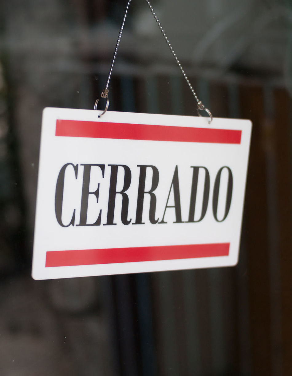 Closed spanish store Close-up Closed Closed Store Opening Hours Shopping Siesta Spanish Spanish Language Storefront Text