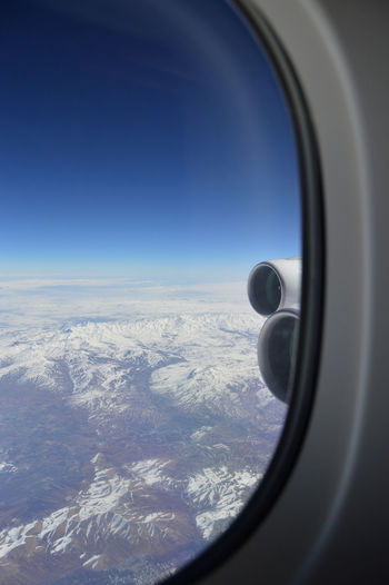 Window seat view in airplane. Snowy mountains in view of aircraft in the air. Clear Sky Tourist Travelling ✈ Aerial View Air Vehicle Aircraft Wing Airplane Airplane Wing Backgrounds Beauty In Nature Day Flying Indoors  Jet Engine Journey Landscape Mid-air Mountains And Sky Nature Scenics Sky Snowy Mountains Transportation Window Window Searching For Summer
