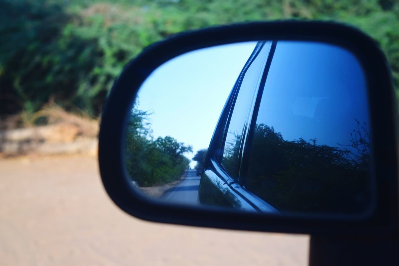 side-view mirror, car, reflection, tree, transportation, land vehicle, road, window, no people, vehicle mirror, mode of transport, road trip, day, nature, outdoors, forest, landscape, close-up, sky