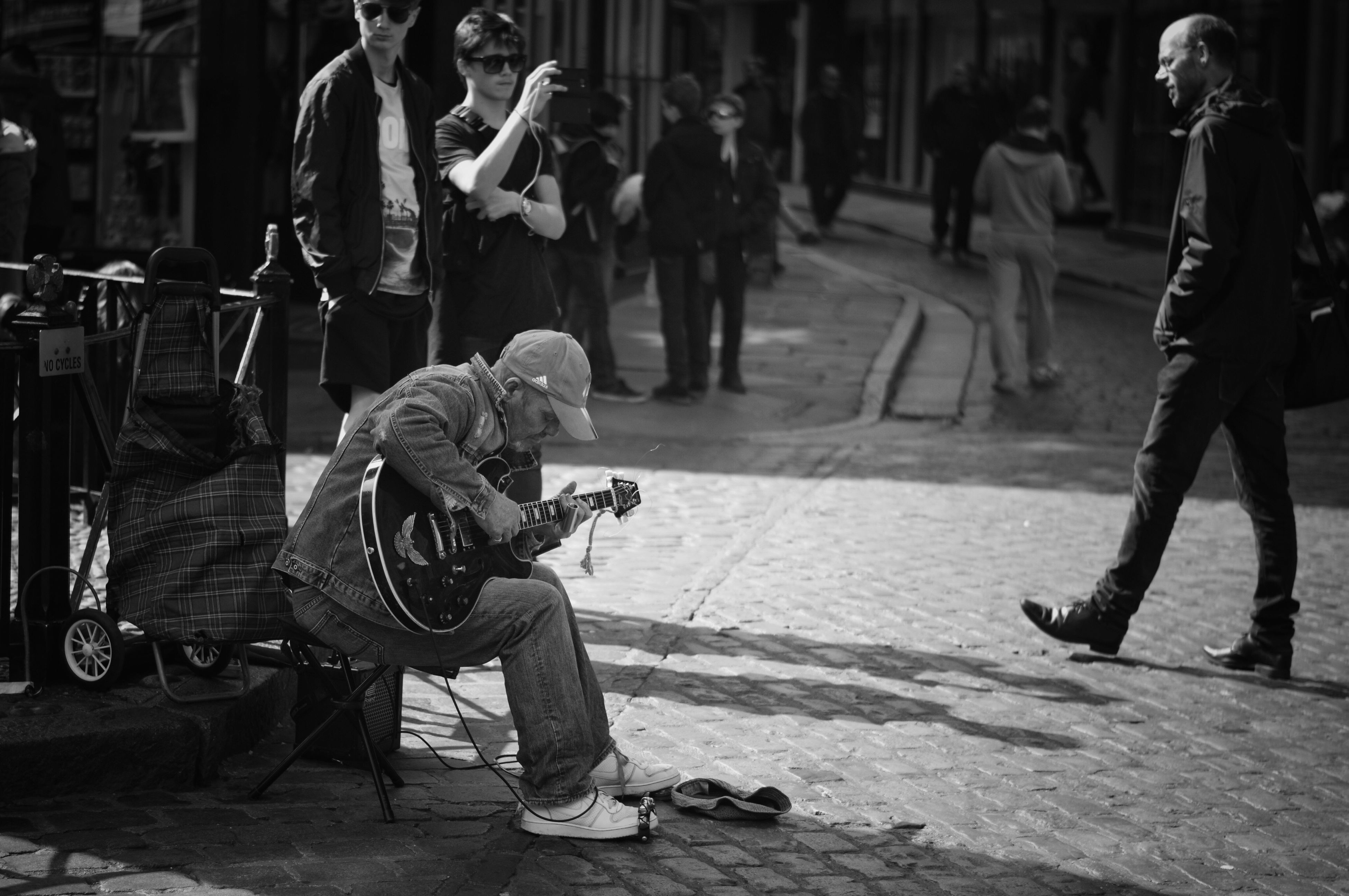 street musician, plucking an instrument, people, musician, adult, men, social issues, crowd, adults only, outdoors, day