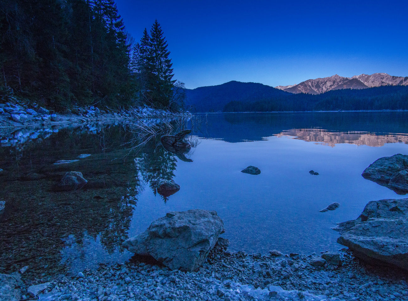 Alps Beauty In Nature Blue Cold Temperature Day Eibsee Forest Lake Landscape Mountain Mountain Range Natural Parkland Nature No People Outdoors Reflection Scenics Sky Snow Tree Water Zugspitze