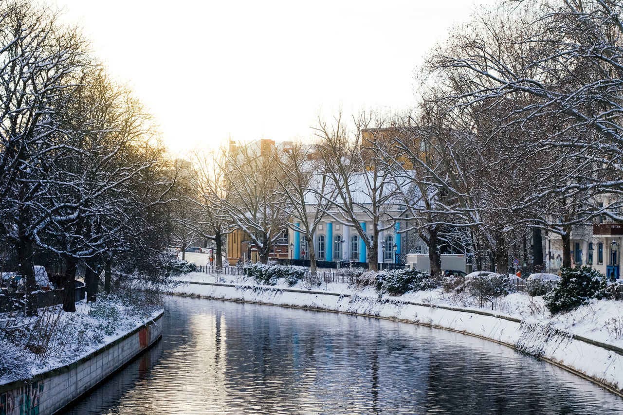 Architecture Bare Tree Beauty In Nature Berlin Building Exterior Built Structure Cold Temperature Day Kreuzberg Maybachufer Nature No People Outdoors River Sky Snow Sunset Tree Water Winter Winter