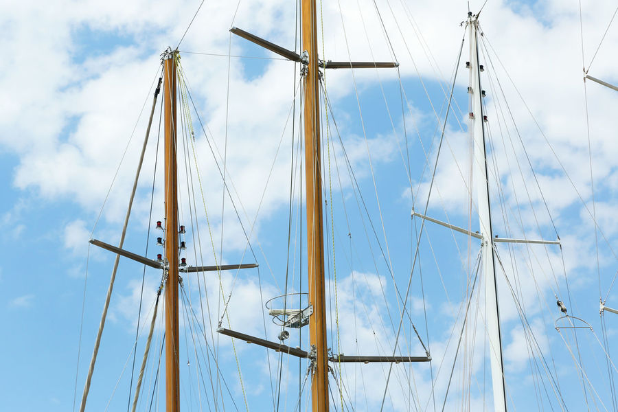 Masts of the motor sailing yachts in Bodrum Marina in Turkey Backgrounds Bodrum Luxury Marine Mast Sailing Sails Sea Port Ship Ship Building Sky Tower Turkey Vessel Yacht Yachting