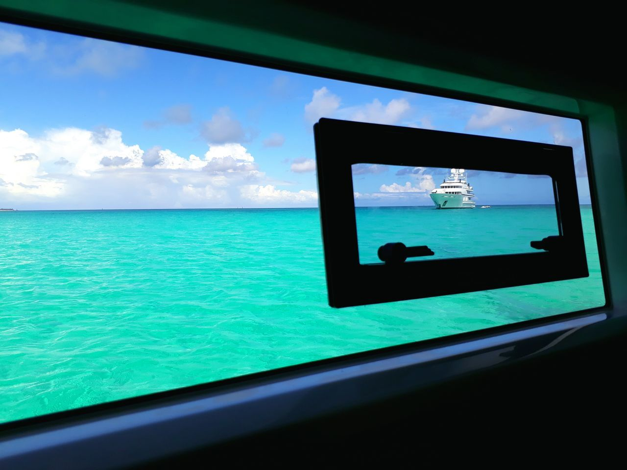 technology, sea, wireless technology, photography themes, photographing, communication, window, water, device screen, sky, close-up, indoors, mobile phone, horizon over water, no people, camera - photographic equipment, day, nature, beauty in nature, photo messaging