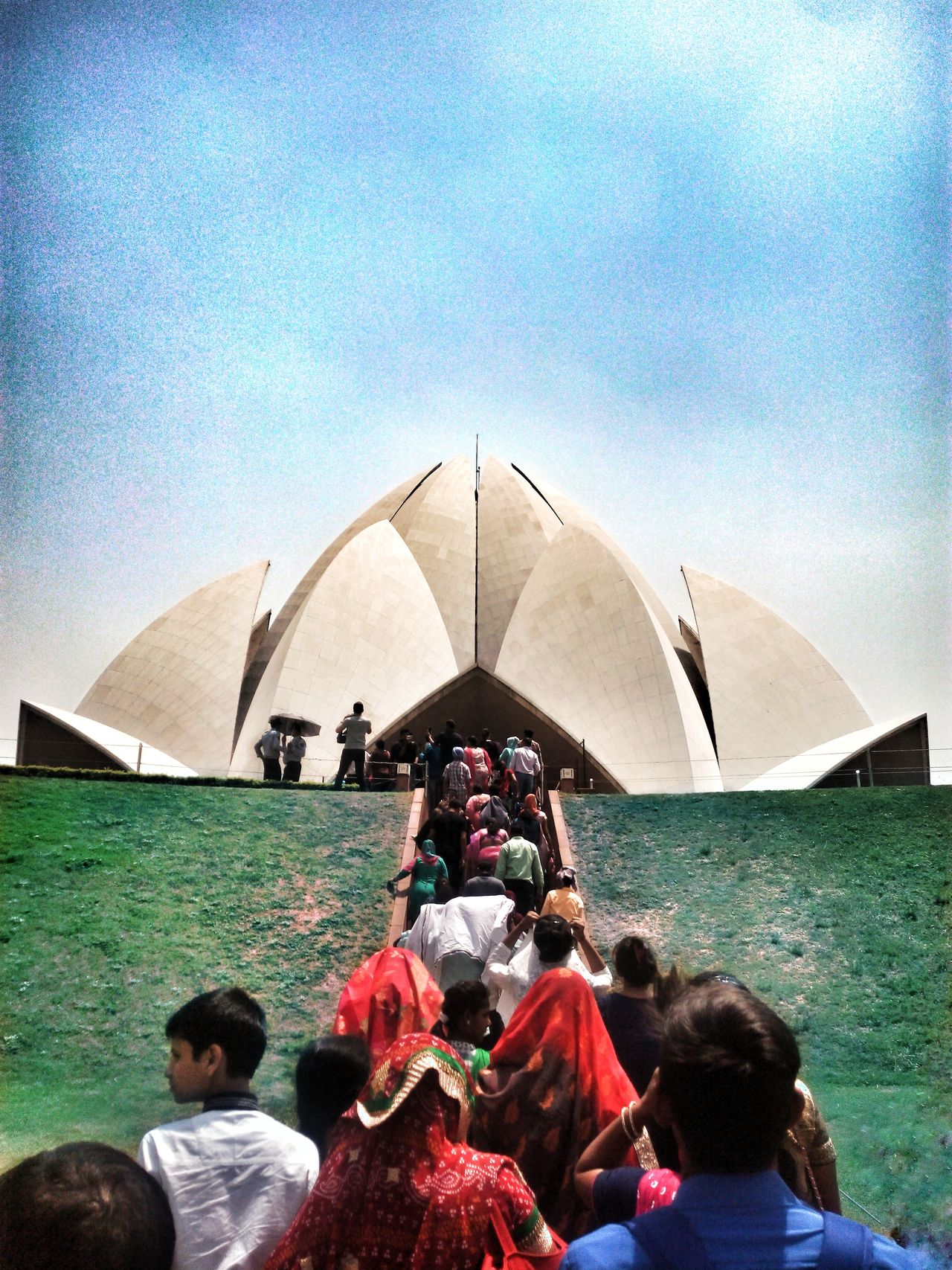 It's a Lotus Temple located at New Delhi, India. It's actually a church built in 90th century. It is the place where you can find peace in your heart. Real People Outdoors Women Adult Sky People Day Incridibleindia Overview Artofvisuals Exolore Your City India The Great Outdoors - 2017 EyeEm Awards EyeEmNewHere Architecture The Photojournalist - 2017 EyeEm Awards The Architect - 2017 EyeEm Awards Built Structure Visualsoflife Symmetry_seekers Place Of Worship Spirituality Live For The Story Let's Go. Together.