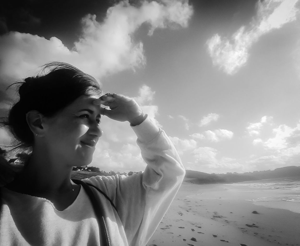 One Woman Only Cloud - Sky One Person Adult Water Beach Headshot Sand Nature Human Body Part Sea Eyem Best Shots Bretagne France EyeEm Gallery Capture The Moment Sunlight Looking Around Light And Shadow Blackandwhite Photography Blackandwhite Shadow Portrait Close-up Human Face Windy
