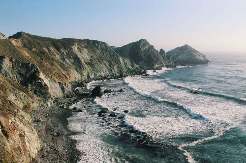 Waves Sea Nature Beauty In Nature Tranquility Scenics Clear Sky Big Sur California Beach Rock - Object Outdoors Water Day No People Wave Sky Mountain Finding New Frontiers EyeEmNewHere Live For The Story