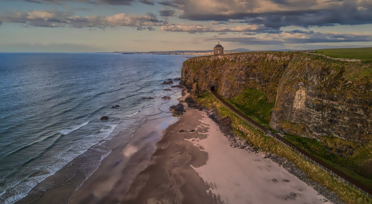Mussenden Temple County Derry, Ireland sea perched at the cliff edge with the Atlantic Ocean below. Dji DJI X Eyeem DJI Mavic Pro Sea Horizon Over Water Nature Scenics Beach Tranquil Scene Cloud - Sky Sunset Outdoors Cliff Landscape_Collection Ireland Aerial View Dronephotography EyeEmBestPics