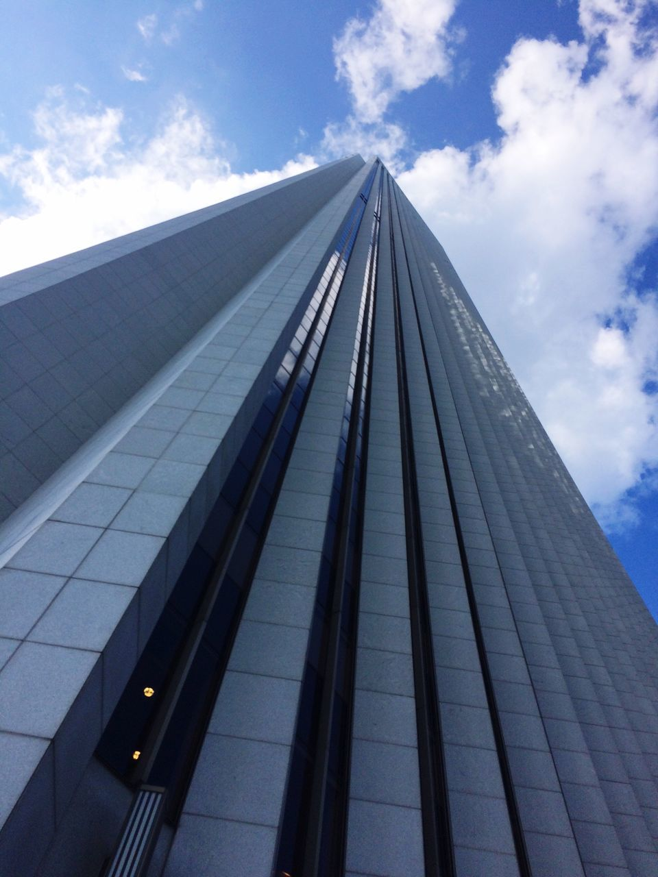 architecture, low angle view, built structure, sky, modern, building exterior, skyscraper, day, tall, outdoors, city, corporate business, growth, cloud - sky, no people, twin