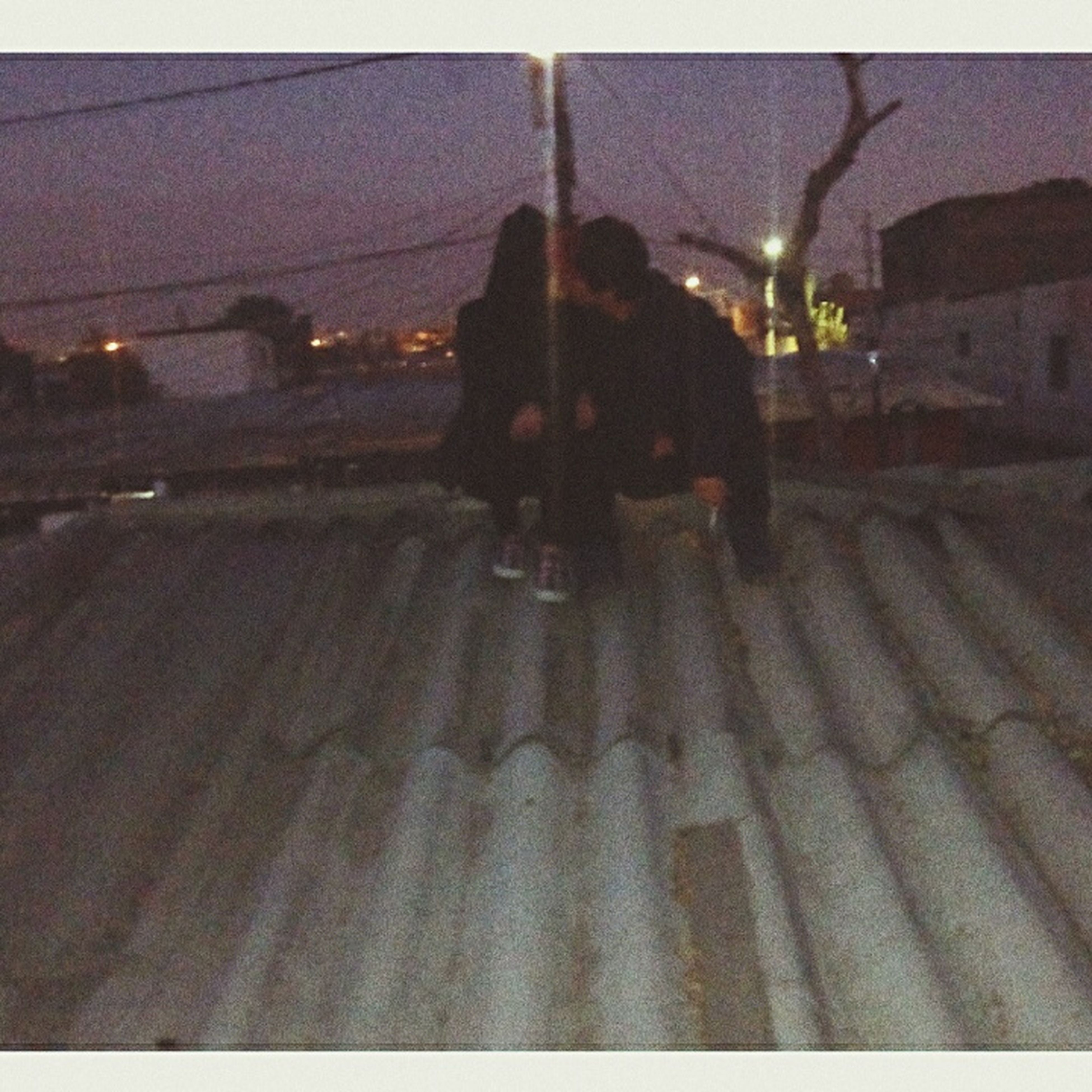night, street light, illuminated, street, wet, transportation, road, lighting equipment, rain, weather, building exterior, built structure, season, silhouette, architecture, outdoors, city, sidewalk, snow, the way forward