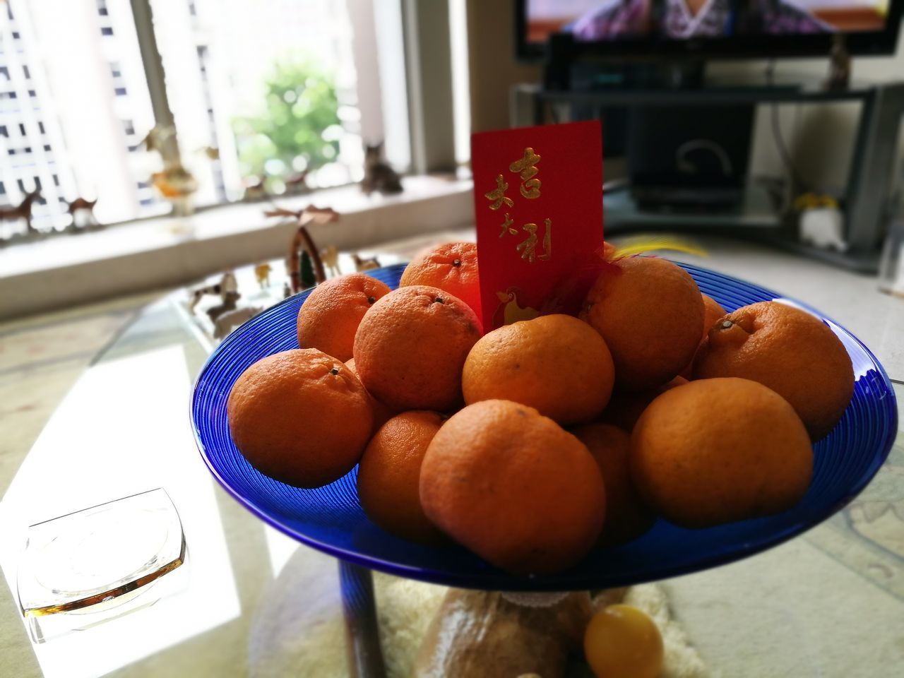It is home Fruit Freshness Healthy Eating Food And Drink Food No People Indoors  Ready-to-eat Close-up Oranges Chinese New Year Lunar New Year Fruit Bowl Living Room Mandarin Oranges Mandarins Tangerines Red Packet Decoration Chinese Symbol Auspicious Fruit Prosperity Auspiciousness