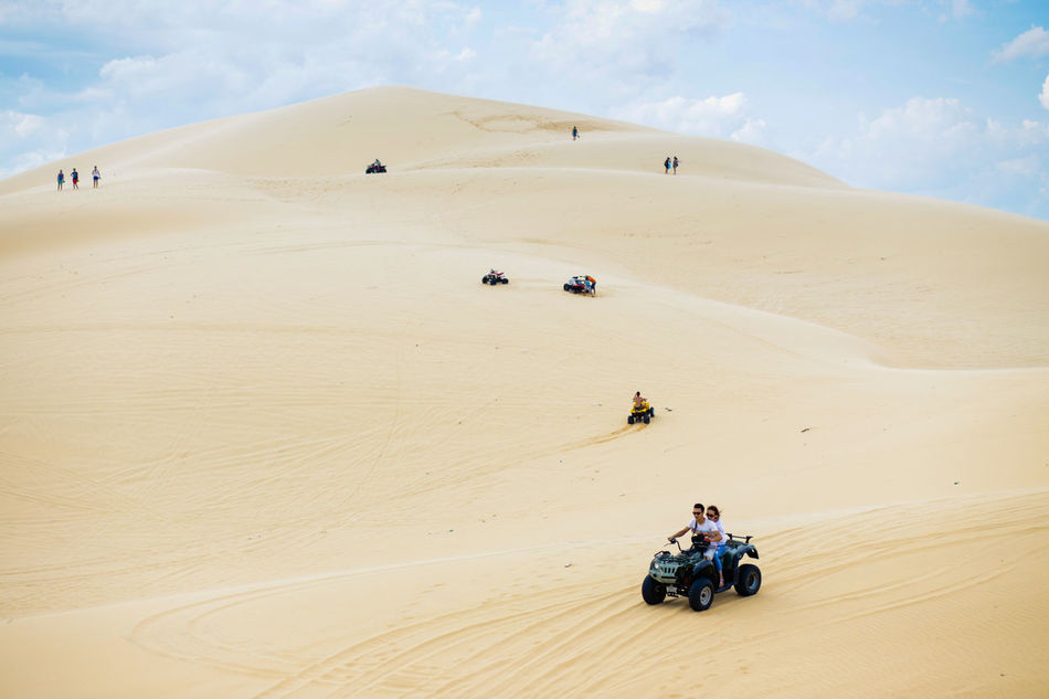 White Sand Dunes, Mui Ne, located in the south of Vietnam. It's about 5-hour away from Ho Chi Minh City. Adventure Arid Climate Beauty In Nature Cloud - Sky Desert Landscape Leisure Activity Lifestyles Mui Ne Muine Muine, Vietnam  Nature Off-road Vehicle Outdoors Riding Sand Sand Dune Sky Transportation Travel Destinations Unrecognizable Person White Sand Dunes Break The Mold