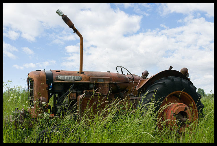 Abandoned Agriculture Broken Day Destruction Farm Field Grass Industry Land Vehicle Mode Of Transport No People Nuffield Obsolete Old Outdoors Ruined Rural Scene Rust RustTshirt Sky Tractor Transportation Wreck