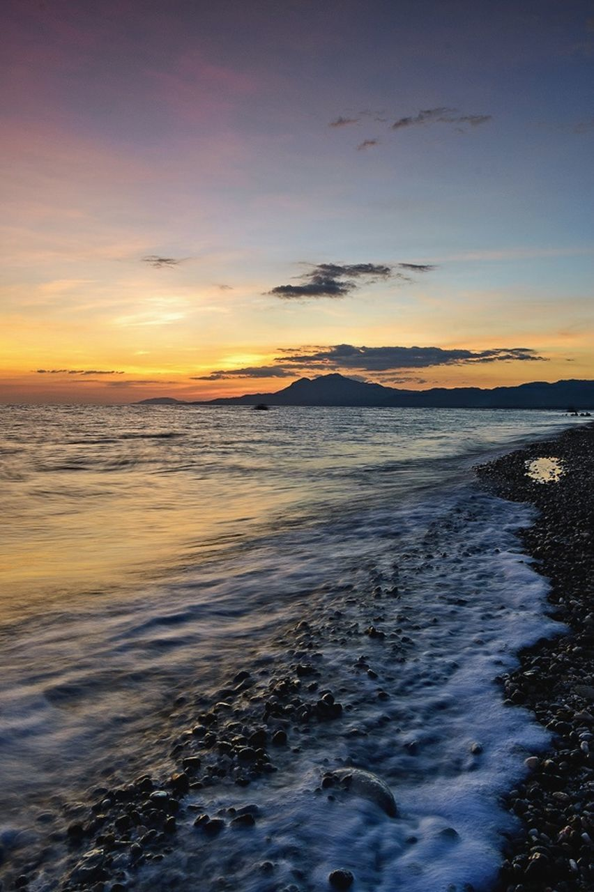 sunset, beauty in nature, sea, scenics, nature, water, tranquility, sky, tranquil scene, no people, outdoors, beach, cloud - sky, wave, horizon over water, day