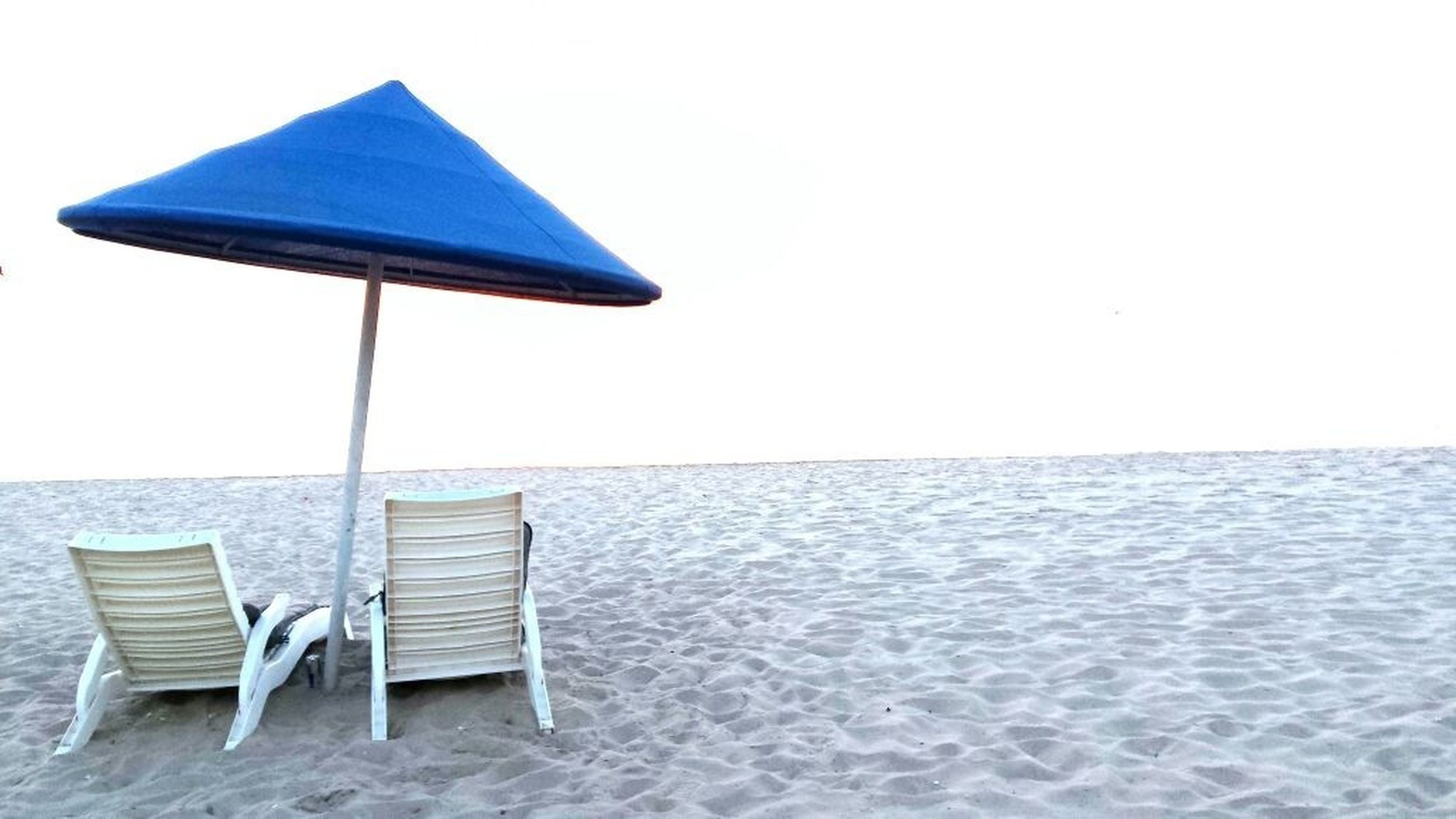 absence, empty, sea, chair, copy space, water, clear sky, horizon over water, tranquil scene, tranquility, beach, table, seat, wood - material, nature, bench, day, scenics, no people, parasol