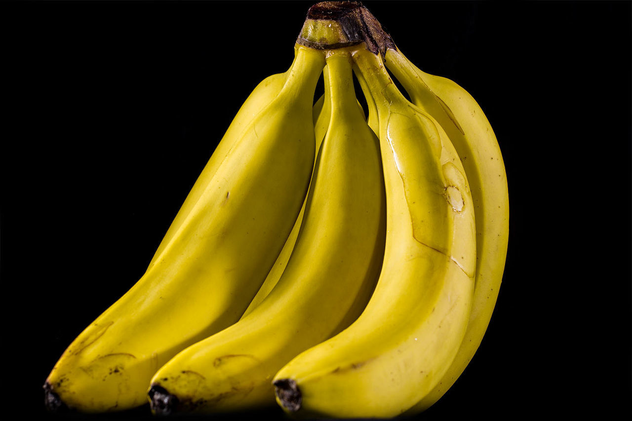 Close-Up Of Bananas Against Black Background
