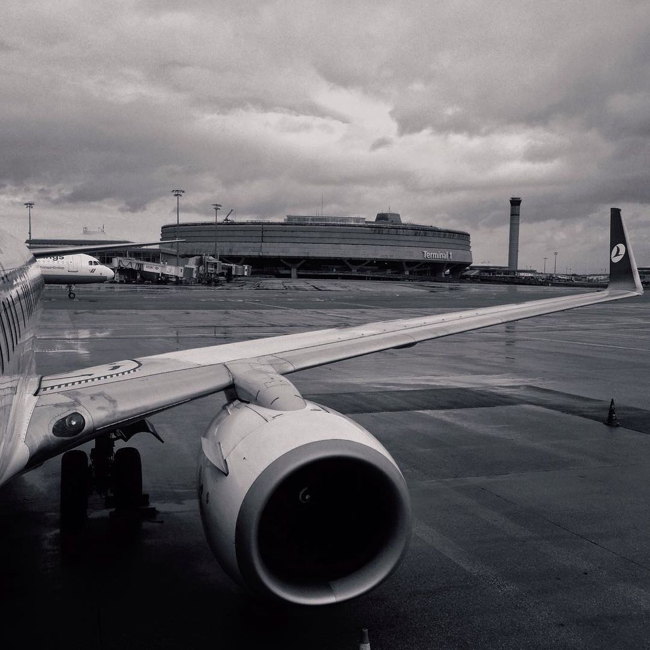 airplane, transportation, airport, airport runway, air vehicle, cloud - sky, sky, mode of transport, jet engine, travel, commercial airplane, outdoors, day, runway, no people