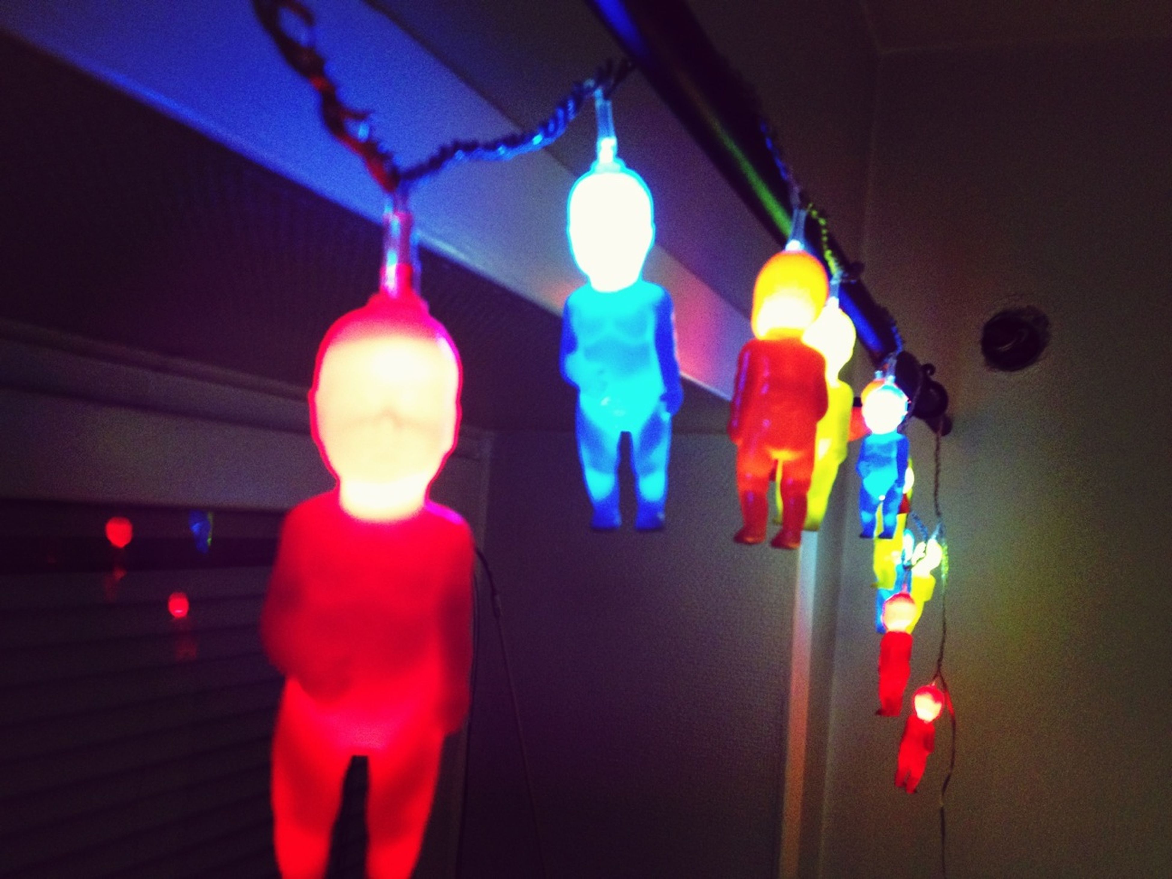 illuminated, indoors, lighting equipment, hanging, decoration, night, celebration, glowing, multi colored, electricity, candle, low angle view, light - natural phenomenon, lit, electric light, lantern, close-up, christmas, christmas decoration, decor