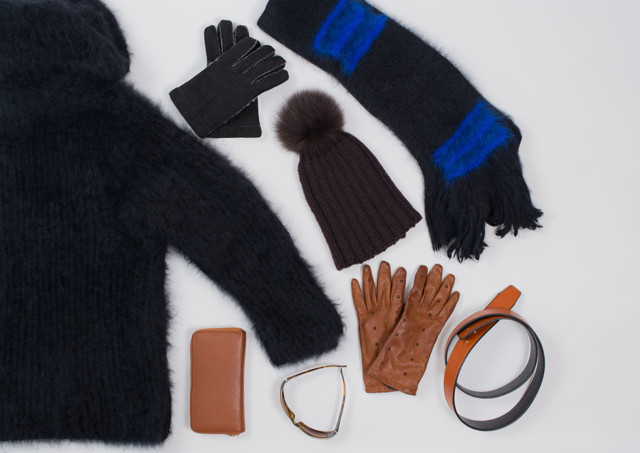 Winter fashion accessories in Flat Lay Still on white Accessories Angora Shawl Angora Sweaters Belts Cut Fashion Flat Lay Flat Lay Fashion Flat Lays Gloves Isolated Leather Gloves Purse Scarf Sunglasses Warm White Background Winter Winter Fashion Woolen Hat