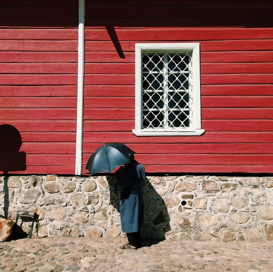 The man with umbrella VSCO Streetphoto Street Photography Streetphotography Burnmyeye Street Spicollective One Person One Man Only Spirituality Vscocam Standing Man Umbrella Travel Pskov Pechory Monastery Red