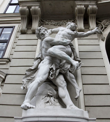 Hercules fighting Antaeus statue at the Royal Palace Hofburg,Vienna, Austria Antaeus Austria Castle Dynasty Emperor Ferdinand Fighting Franz Habsburg Hercules History Hofburg Monument Museum Mythology Palace Power Residences Royal Sculpture Statue Stone Travel Urban Vienna