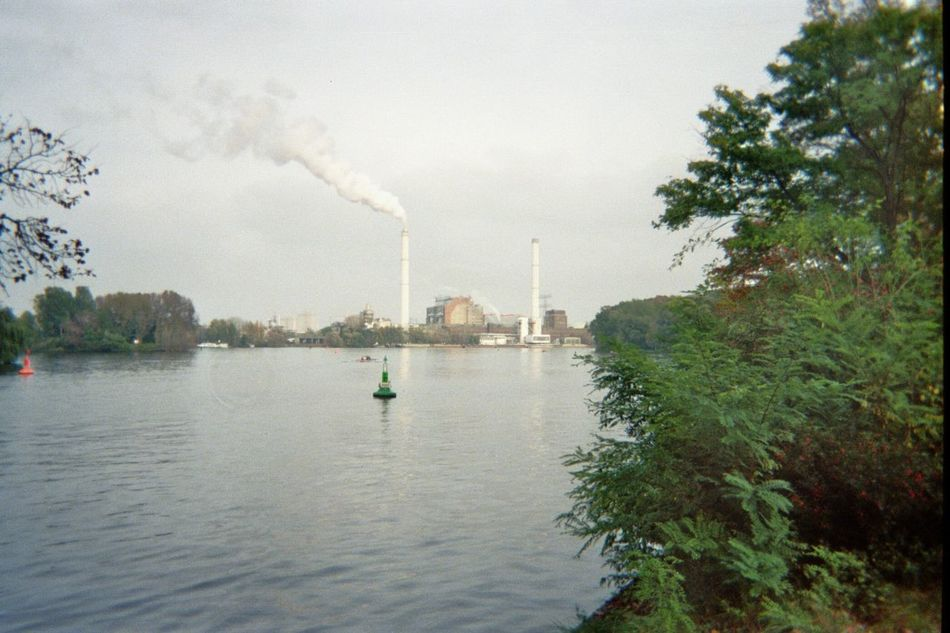 Berlin Cloud - Sky Day Distant Factory Growth Kodak Nature Rda River Riverbank Scenics Sky Tranquil Scene Tranquility Tree Treptower Park Water Waterfront