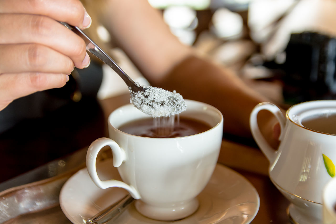 Ceylon Tea Close-up Cup Day Drink Food Food And Drink Freshness Holding Hot Beverage Human Body Part Human Hand Indoors  One Person People Real People Refreshment Saucer Spoon Sri Lanka Sugar Table Tea - Hot Drink Tea Time Woman