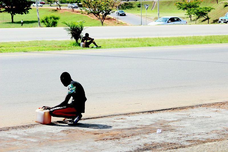 Menatwork Streetphotography AbujaPhotographer Abuja Nigeria Fuelscarcity Blackmarket Hawking Canon600D Hustlers