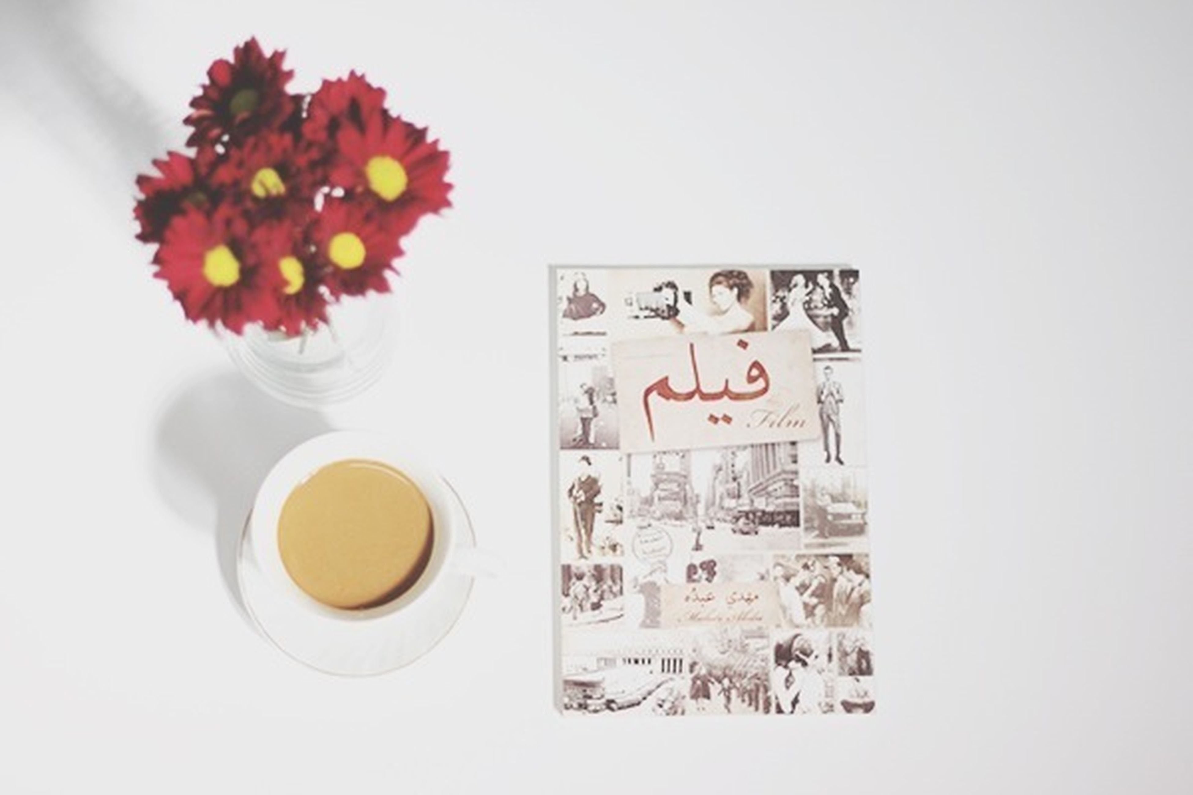 indoors, table, freshness, food and drink, drink, still life, coffee cup, flower, white background, refreshment, studio shot, art, art and craft, cup, creativity, copy space, plate, vase, high angle view, coffee - drink