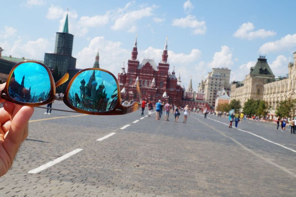 Holidays Architecture Blue Buildings Built Structure Day Hand Holding Holiday Human Body Part Human Hand Large Group Of People Leisure Activity Lifestyles Moscow People Real People Red Redsquare Refelections Reflection Russia Sky Street Streetphotography Sunglasses First Eyeem Photo