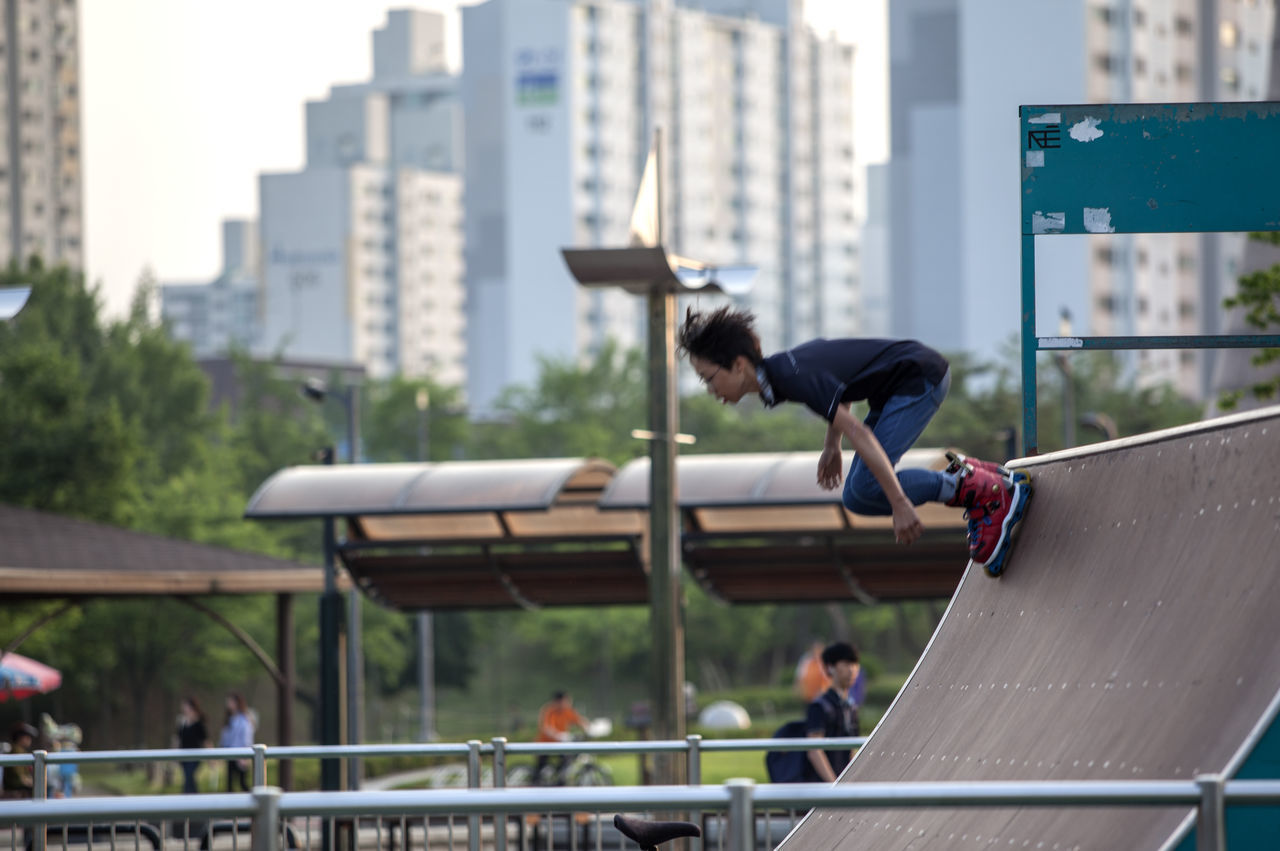Bucheon Lake Park Child City City Life Day Dynamic Focus On Foreground Leisure Leisure Activity Lifestyles Moving Outdoors Railing Roller Skating Runing Selective Focus Sky Sports Travel Destinations