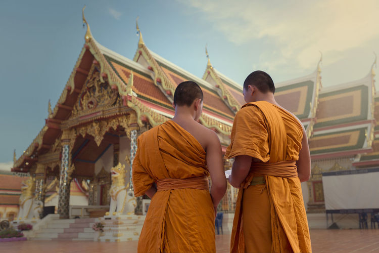 Two novice in the temple thailand ASIA Backside Portrait Buddha Built Structure Casual Clothing Day Faith Leisure Activity Lifestyles Low Angle View Novice Outdoors Sky Temple - Building Thailand Travel Destinations Young Men