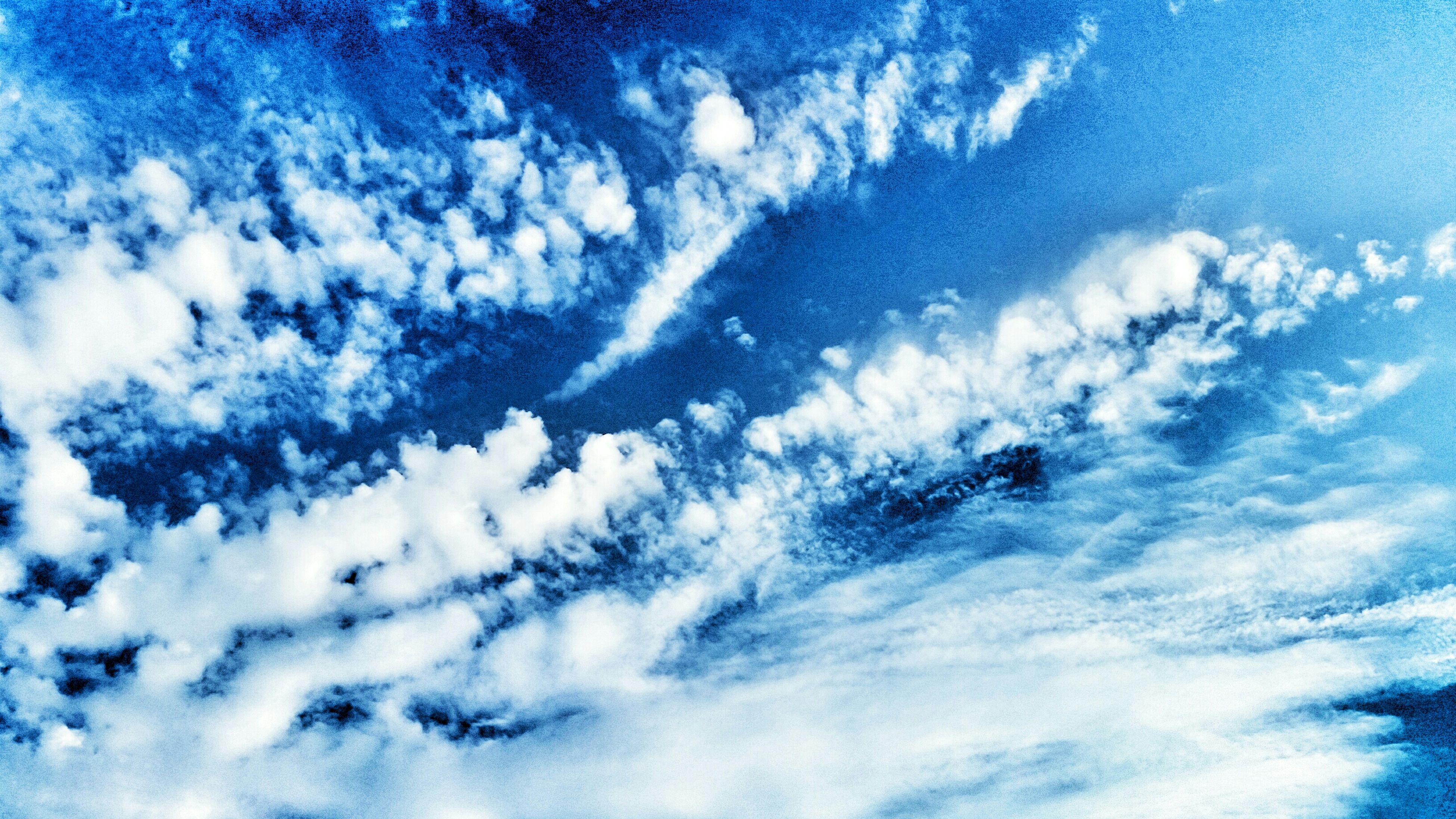 low angle view, blue, sky only, sky, cloud - sky, beauty in nature, backgrounds, tranquility, scenics, full frame, nature, cloudscape, tranquil scene, cloudy, cloud, idyllic, majestic, white color, outdoors, fluffy