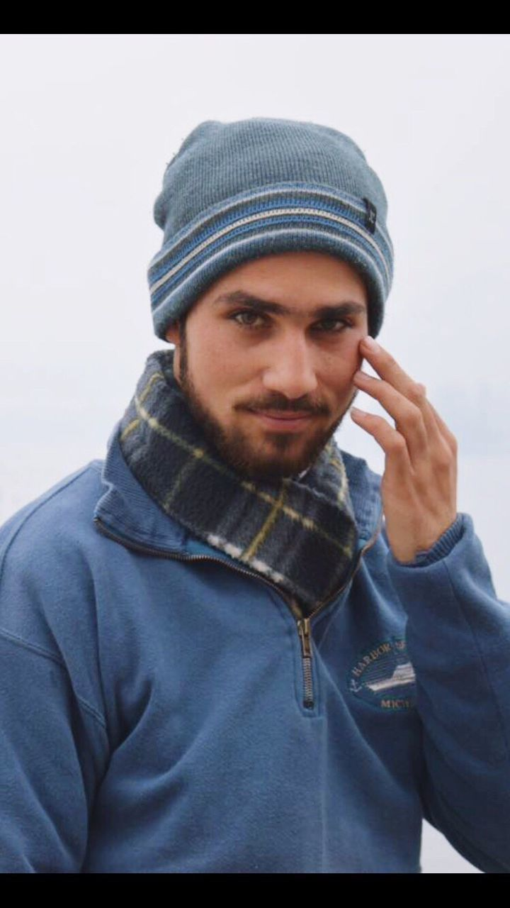 looking at camera, one man only, portrait, one person, only men, headshot, front view, wireless technology, day, knit hat, adults only, communication, people, outdoors, adult, standing, warm clothing, young adult, close-up