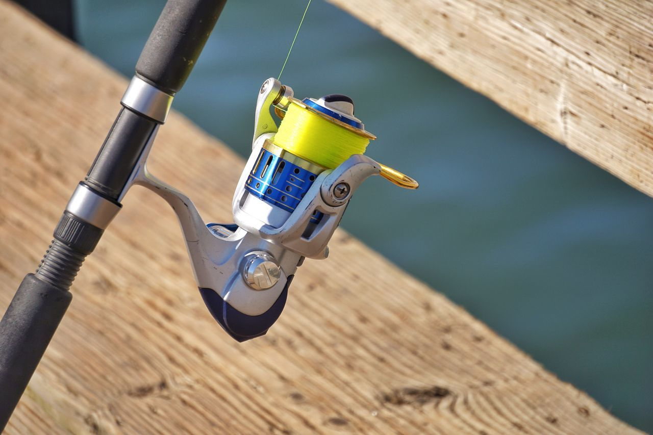 Fishing Pole Focus On Foreground Wood - Material High Angle View No People Table Close-up Fishing Fish Fisher Fishing Time Fishing Pole Reels Fishing Reel Day Indoors