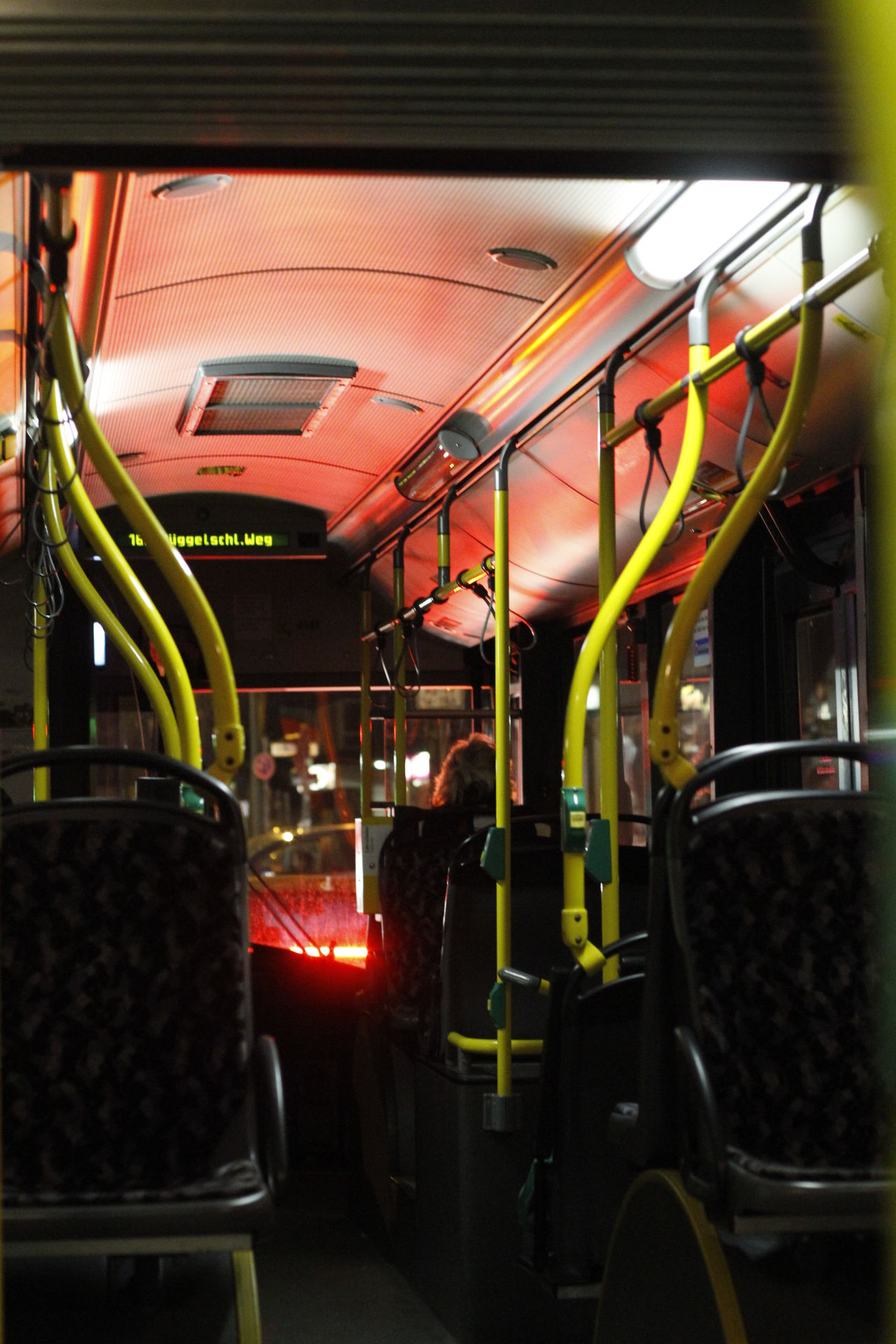 öffentlicher Bus BVG Bus Commuter Train Illuminated Indoors  Land Vehicle Mode Of Transport Night One Person People Public Transportation Rail Transportation Real People Sitting Subway Train Train - Vehicle Transportation Vehicle Interior Vehicle Seat