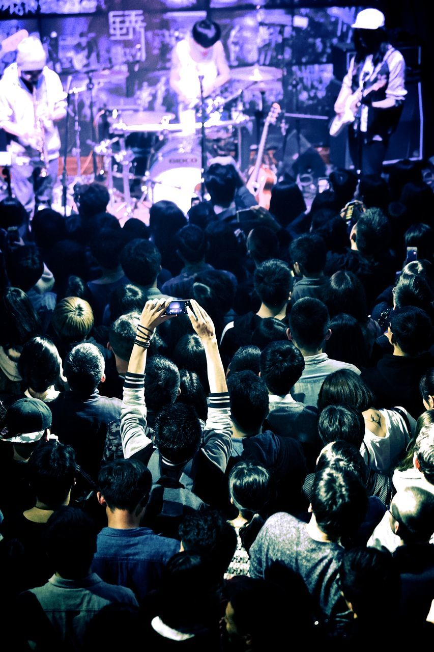 large group of people, crowd, men, real people, rear view, women, audience, togetherness, night, outdoors, popular music concert, people